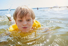 Little boy swimming Stock Photography
