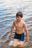 Little boy swimming in a lake Stock Photography