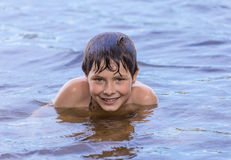 Little boy swimming in a lake Royalty Free Stock Photography