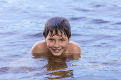 Little boy swimming in a lake Royalty Free Stock Photo