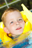 Little boy swimming with life vest on Royalty Free Stock Photography
