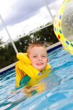 Little boy swimming with life vest on Royalty Free Stock Images