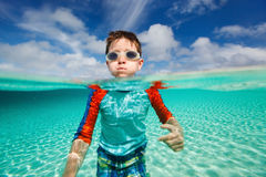 Little boy swimming in ocean Royalty Free Stock Photo