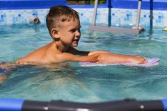 Little boy swimming in the pool royalty free stock photos