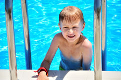 Little boy in swimming pool royalty free stock photography