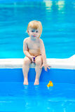 Little boy by the swimming pool Royalty Free Stock Photography
