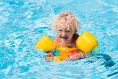Little boy in swimming pool Stock Images