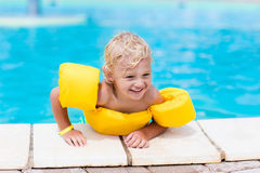 Little boy in swimming pool Stock Image