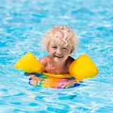 Little boy in swimming pool Stock Photos