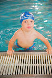 Little boy in the swimming pool Stock Image