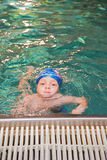 Little boy in the swimming pool Stock Images