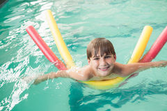 Little boy swimming in the pool Stock Photos