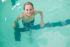 Little boy swimming in the pool Stock Image