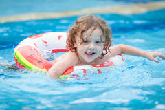 Little boy in the swimming pool  with rubber ring Stock Photo