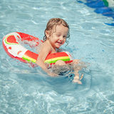 Little boy in the swimming pool  with rubber ring Royalty Free Stock Photo