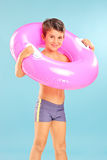 Little boy with a swimming ring around his neck stock images