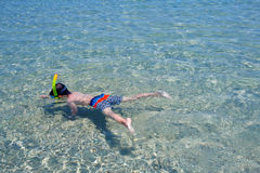 Little boy swimming in a shallow water Royalty Free Stock Photo