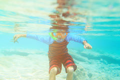 Little boy swimming and snorking in ocean Royalty Free Stock Photo