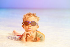 Little boy swimming at tropical beach Stock Photo