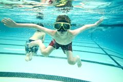 Little boy swimming underwater Stock Photo
