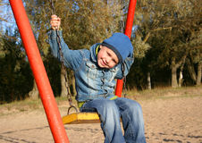 Little boy on swing Stock Photos