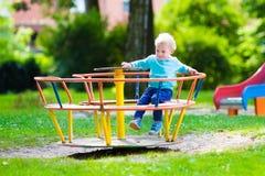 Little boy on a swing Stock Image