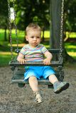 Little boy swinging Royalty Free Stock Photos