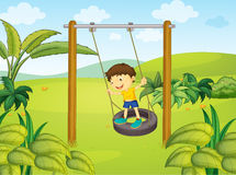 A little boy swinging Stock Photo