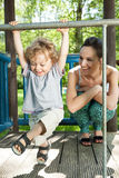 Little boy swinging on monkey bars Royalty Free Stock Image