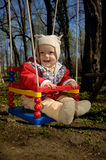 Little Boy swings Royalty Free Stock Photo