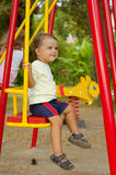 Little boy on swings Royalty Free Stock Photo