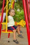 Little boy on swings. Park; outdoors; summer Royalty Free Stock Photo
