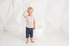 Little boy in a t-shirt and shorts on a white background Royalty Free Stock Photos