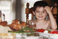 Little boy at table Royalty Free Stock Images