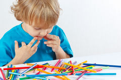Little boy at the table with color pencils Stock Images