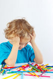 Little boy at the table with color pencils Stock Photography