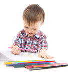 A little boy at the table draws Stock Photography