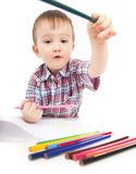 A little boy at the table draws Royalty Free Stock Photography