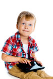 Little boy with a tablet computer Stock Image