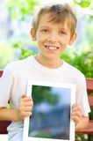 Little boy with tablet Royalty Free Stock Photo