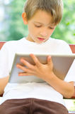 Little boy with tablet. Cute little boy with tablet computer outdoors Royalty Free Stock Photo