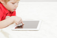 Little boy with tablet, early learning Royalty Free Stock Photo