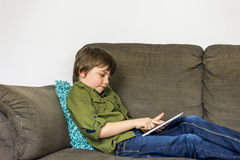 Little boy with tablet Stock Images