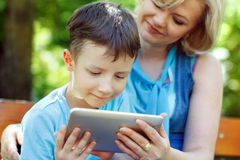 Little boy with tablet and mother Royalty Free Stock Photography