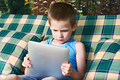 Little boy with tablet pc Stock Image