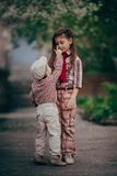 Little boy tach sister eyes Royalty Free Stock Photos