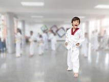 Little boy in taekwondo class indoor activities Stock Photos
