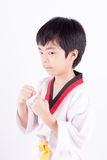 Little boy in a Taekwondo suit Stock Photography