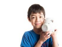 Little boy take a saving money in piggy bank Stock Photos
