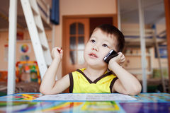 Little boy takes an important call on his cell Stock Photography